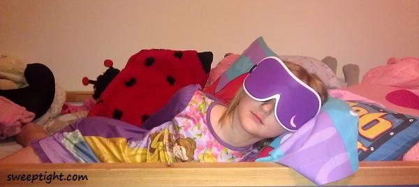 kid wearing sleep eye mask