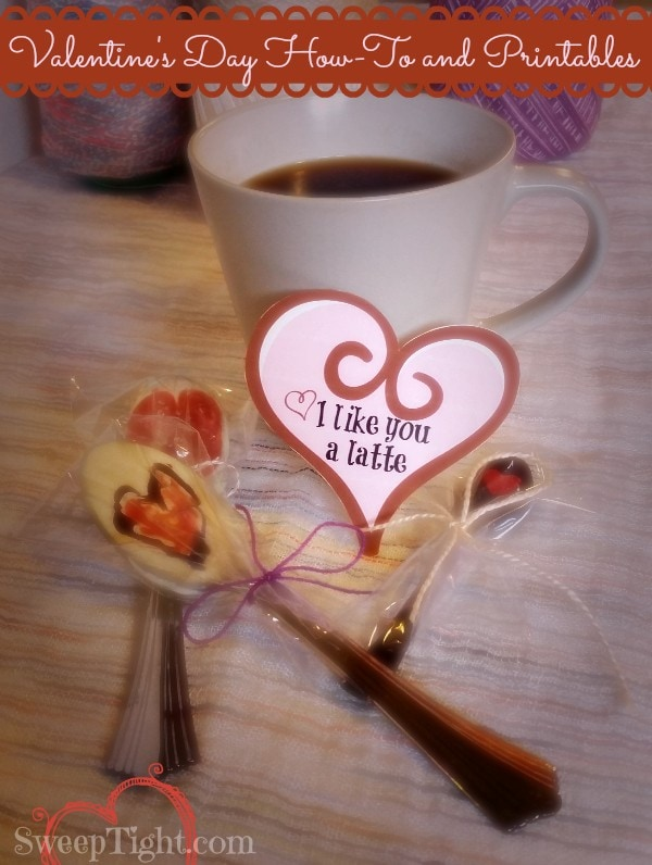 Chocolate dipped Valentine's Day spoons sitting by a cup of coffee