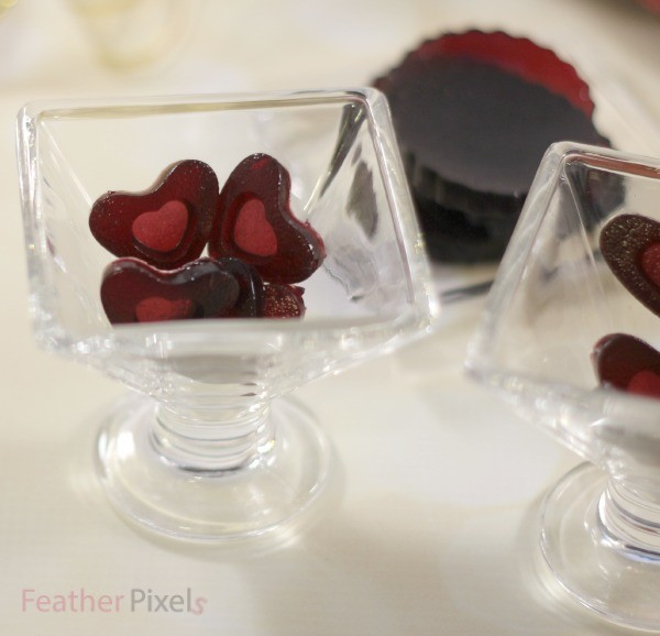Red wine gummies in various shapes and sizes