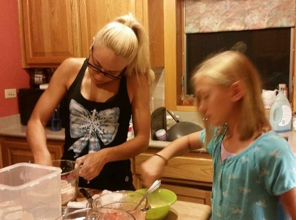 Bikini fitness competitor baking with my daughter. So cute. Awesome role model. Beauty supply