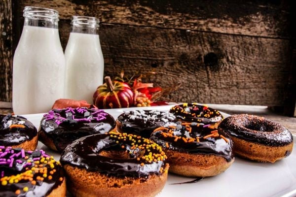 Donuts with dark chocolate glaze and halloween sprinkles