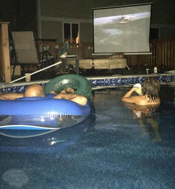 Watching Jaws from rafts in the pool