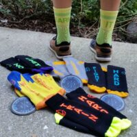 LOVE all these tall colorful socks with inspirational sayings on them! #InspyrSocks