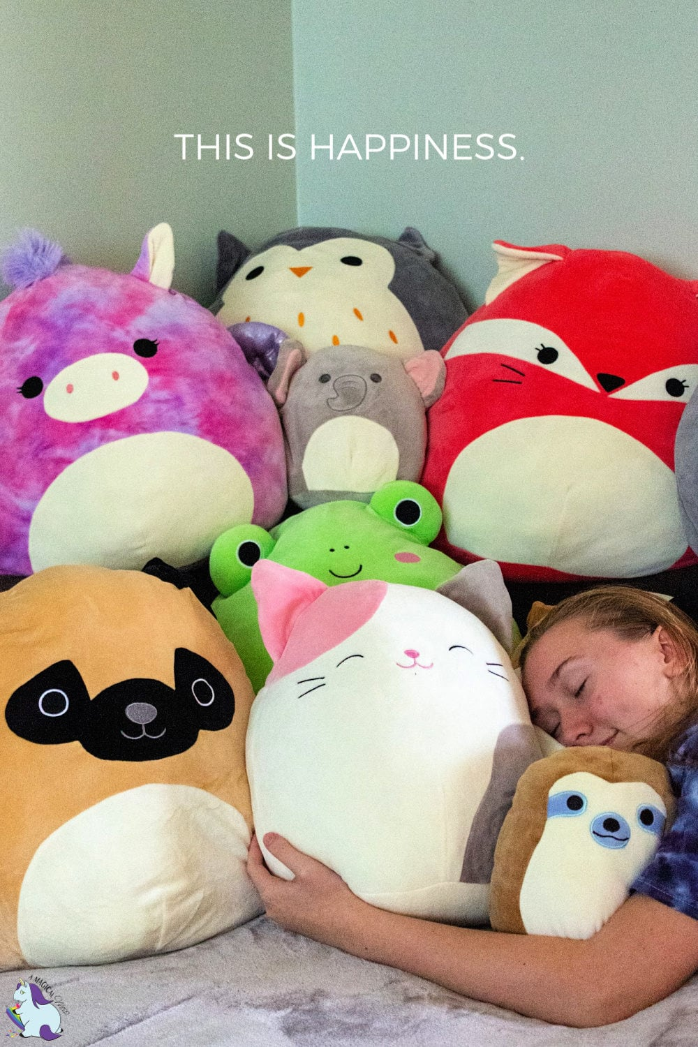 Teen girl hugging a stack of Squishmallows - These are the best gifts for EVERYONE!