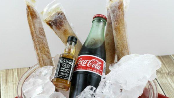 Bottle of Jack, bottle of Coke, and frozen pops of Jack and Coke