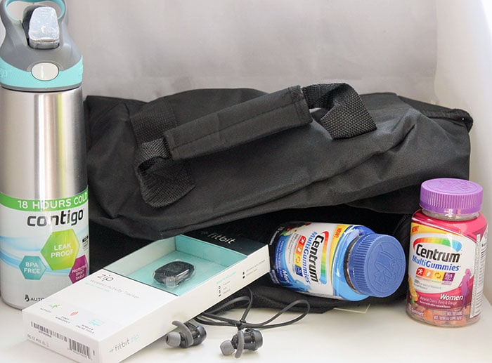 Gym bag stocked with healthy motivators
