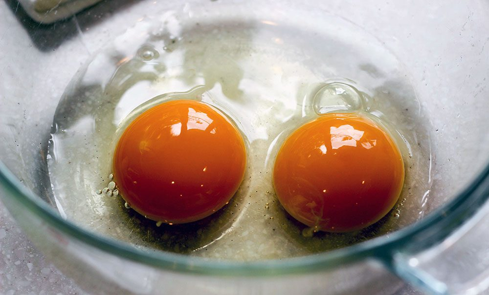 Farm fresh eggs have a deep orange yolk