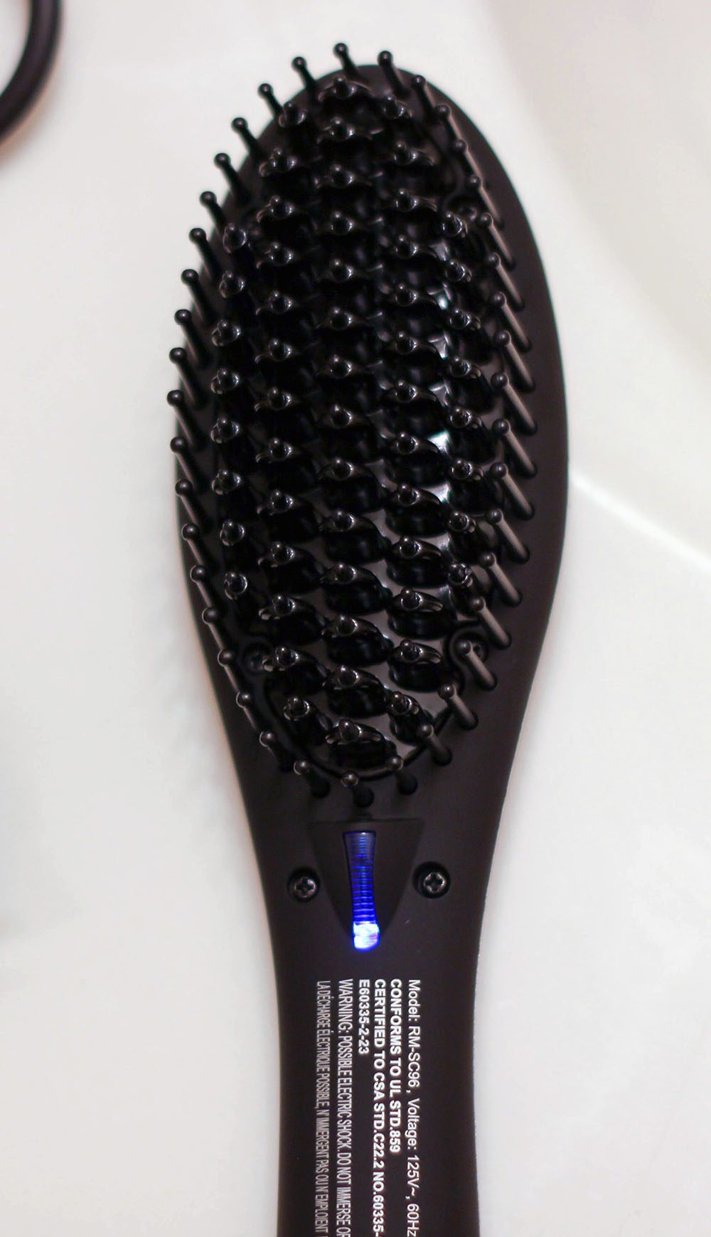 Heated hair brush for straightening and smoothing hair