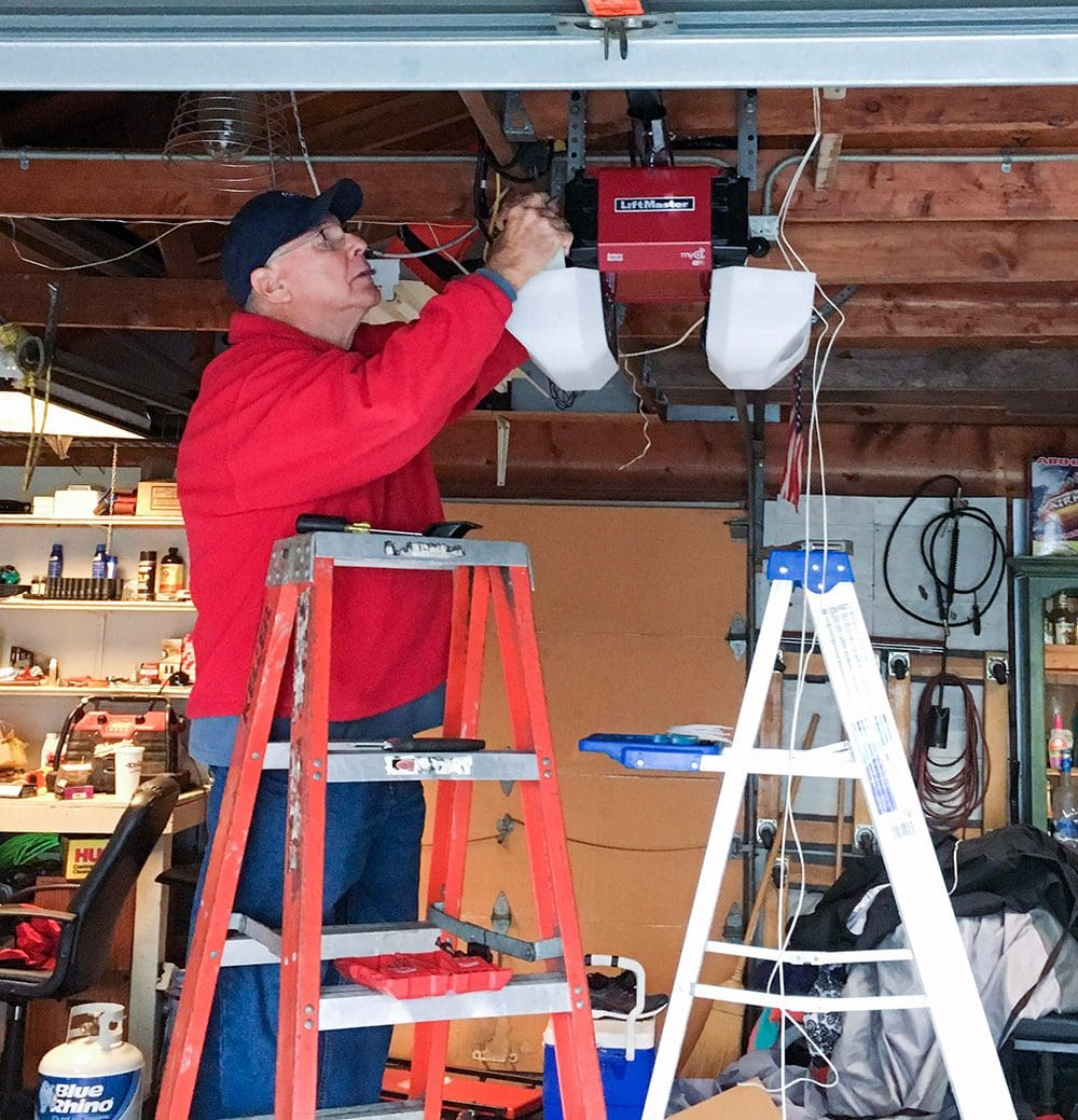 Jack Helson installing our new LiftMaster garage door opener.