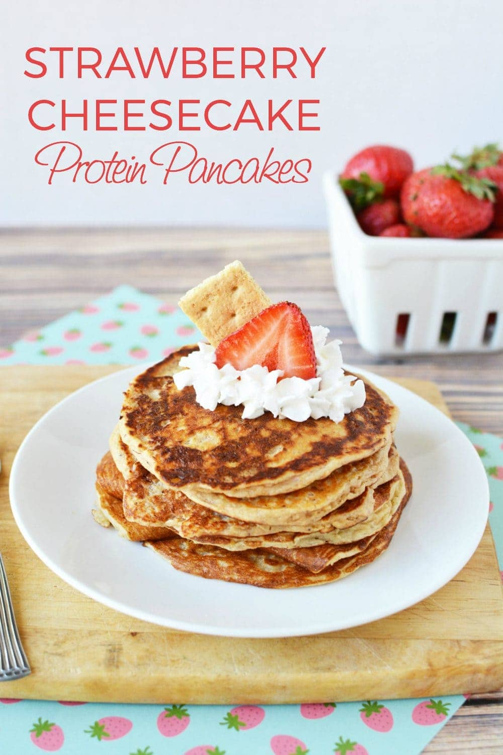 Pancakes with whipped cream and strawberry on top