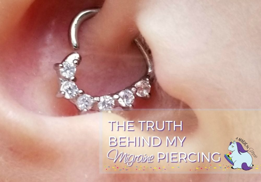 Daith piercing in an ear with a heart ring