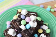 Brownies with marshmallow and candies on a plate