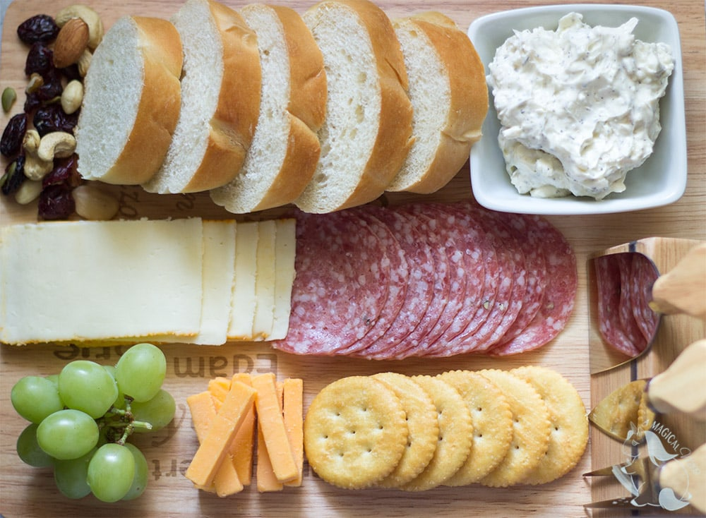 Charcuterie board with garlic spread