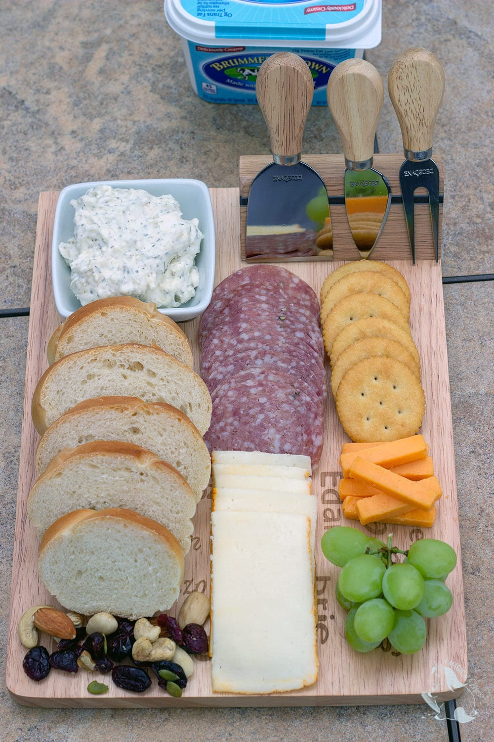 Meat and cheese board with garlic spread for bread