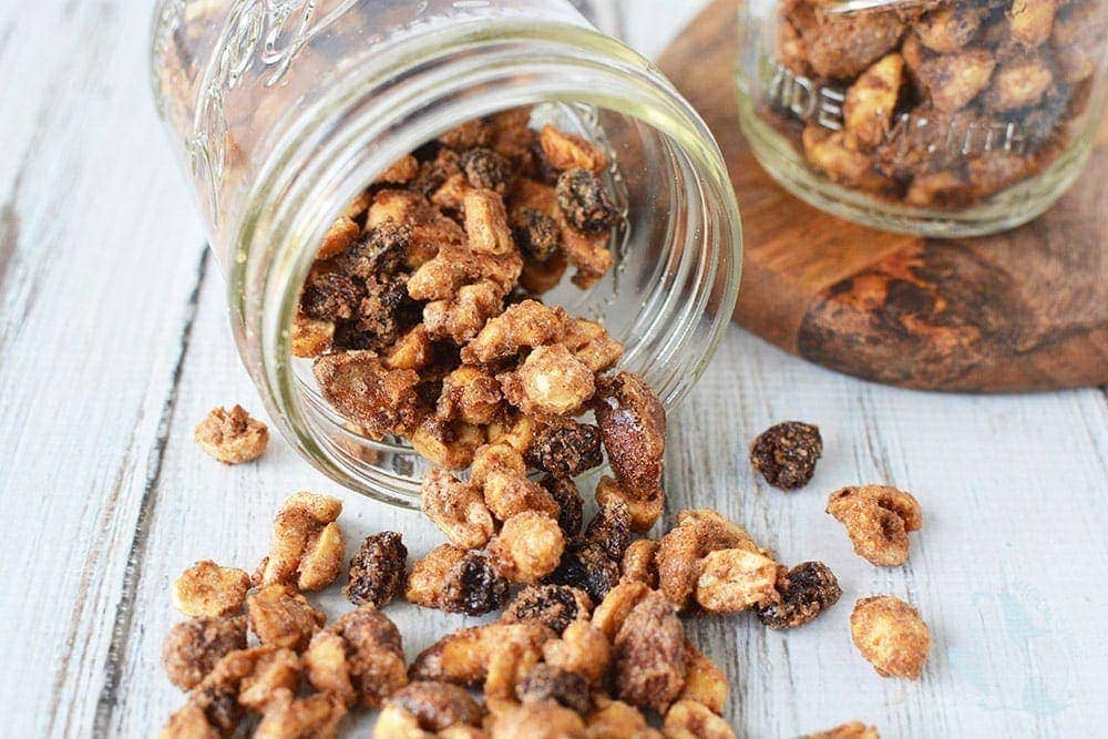 Snack mix with nuts and raisins dumped out of mason jar