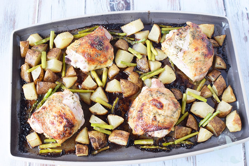 Chicken thighs with vegetables and potatoes on a sheet pan