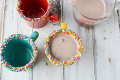 Rainbow sprinkles on rim of mug for magical hot chocolate