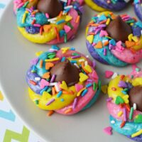 Sparkly and fun unicorn poop cookies on a plate