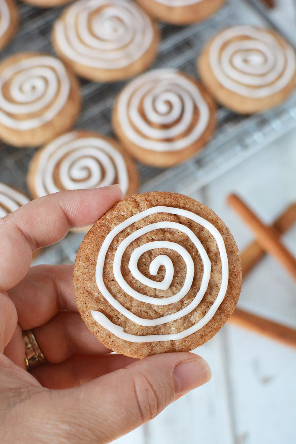 Holding a cinnamon roll cookie to show the detail