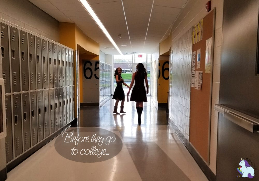 two girls walking down the hall in school