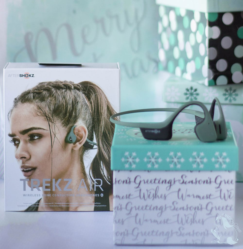 Aftershokz headphones sitting on gift box