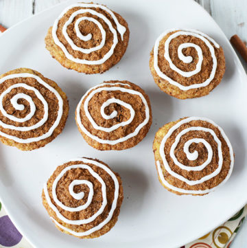 Overhead picture of cinnamon roll muffins on a white plate.