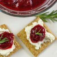 Homemade cranberry jam recipe served on Triscuit crackers with cream cheese.