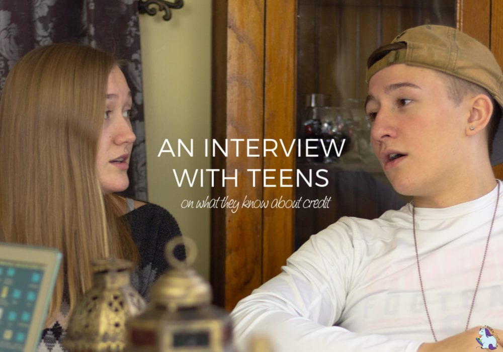 Two teens talking at a table