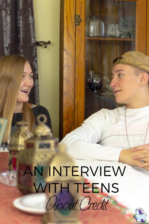 2 teens sitting at table talking