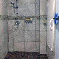 Shower next to the sensory deprivation tank door.