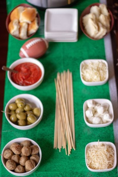 A table full of ingredients to make meatballs sliders or skewers