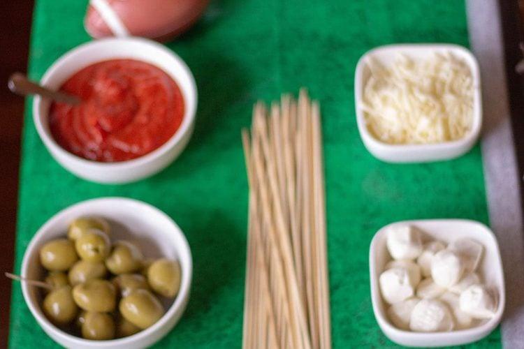A table full of ingredients to make meatballs sliders or skewers