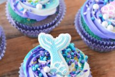 swirled blue and purple cupcakes with fins