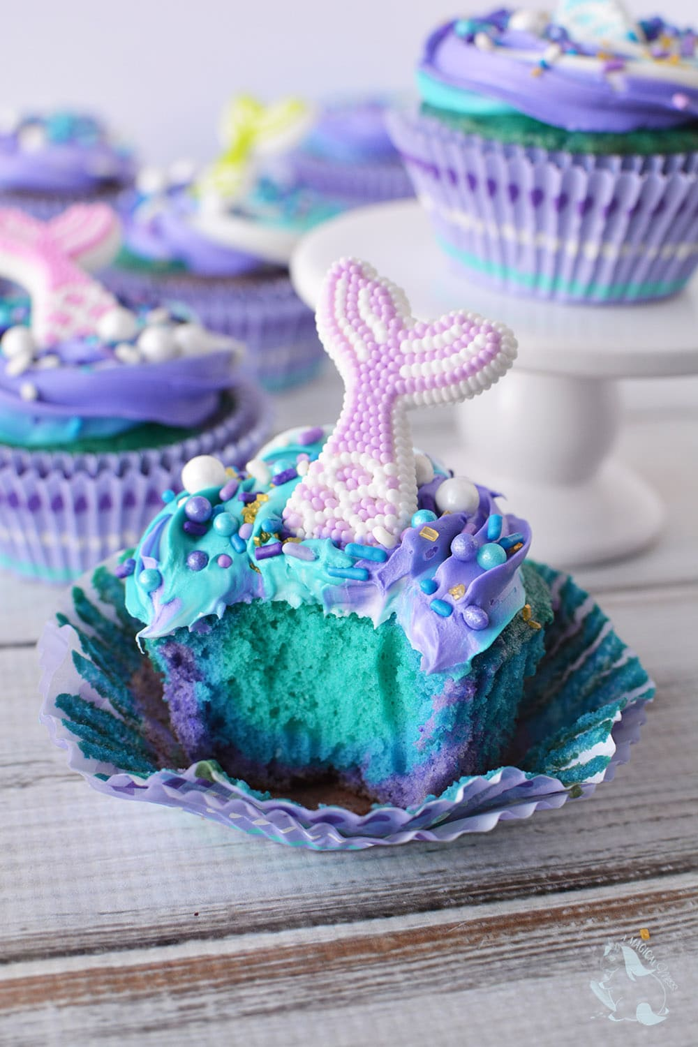 Blue and purple cupcake with a bite taken out.