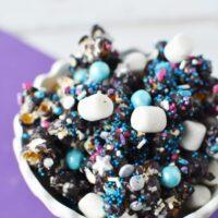 candied popcorn in white dish on purple napkin
