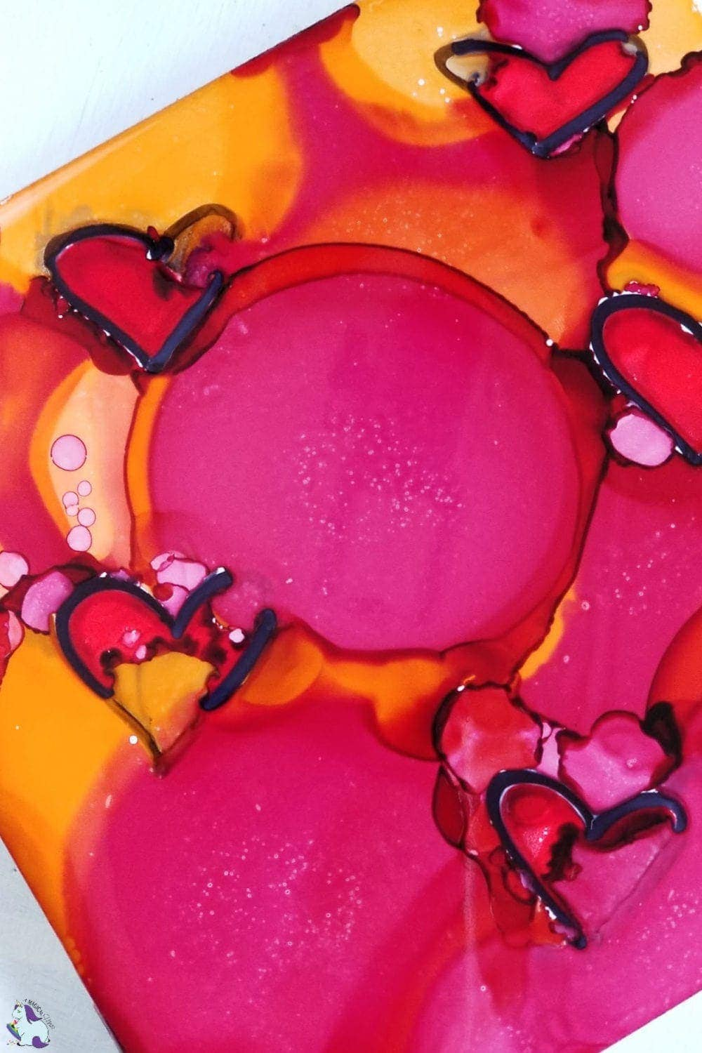 red hearts in alcohol ink on tile