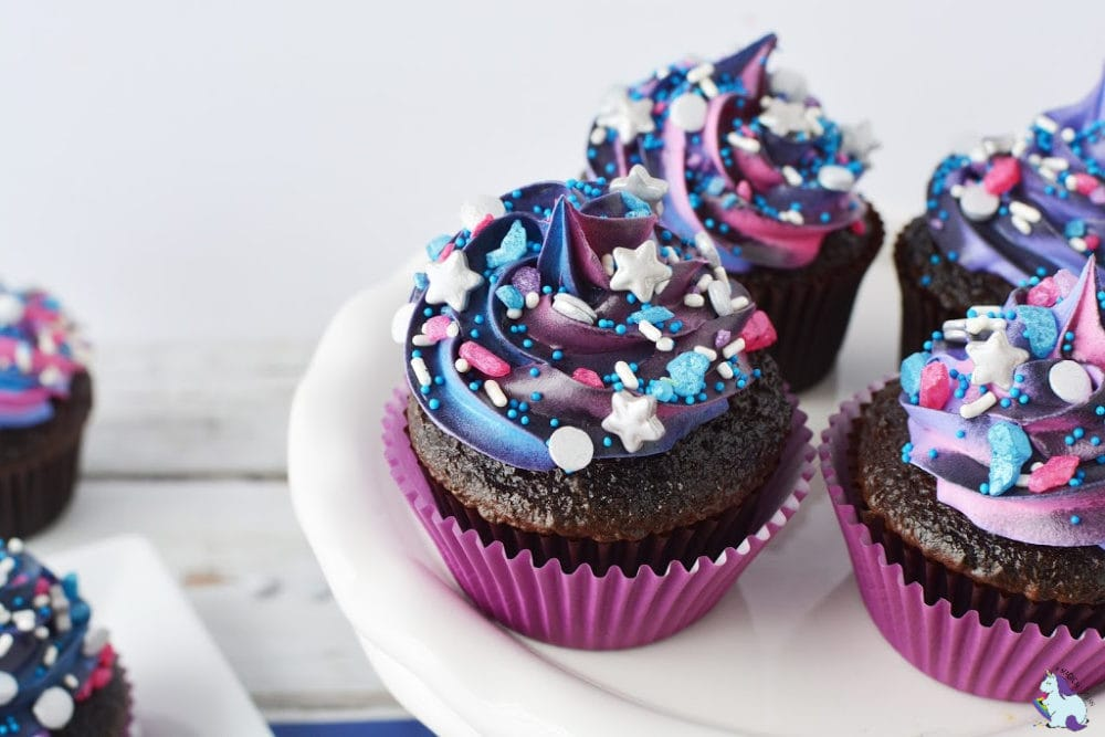 galaxy cupcakes on white plate