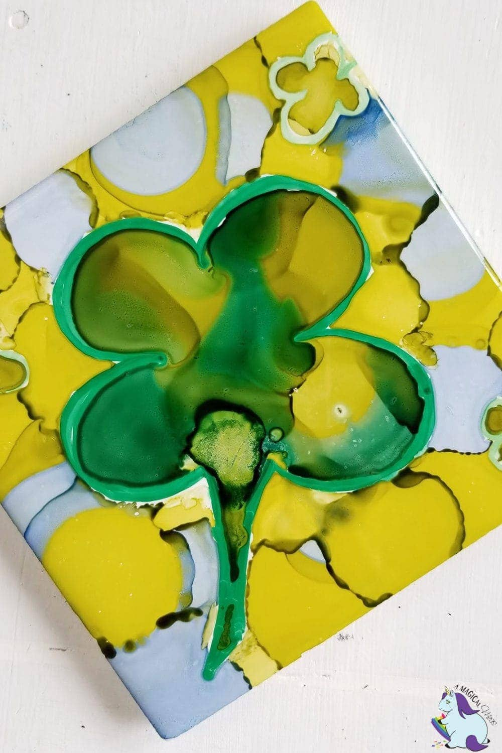 abstract four leaf clover in alcohol ink on tile