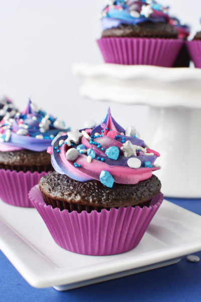 decorated cupcakes on white dishes