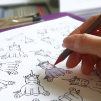Unicorn coloring page with colored pencil coloring