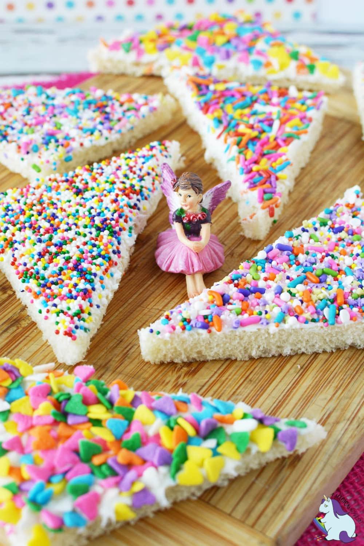 Colorful fairy bread on cutting board