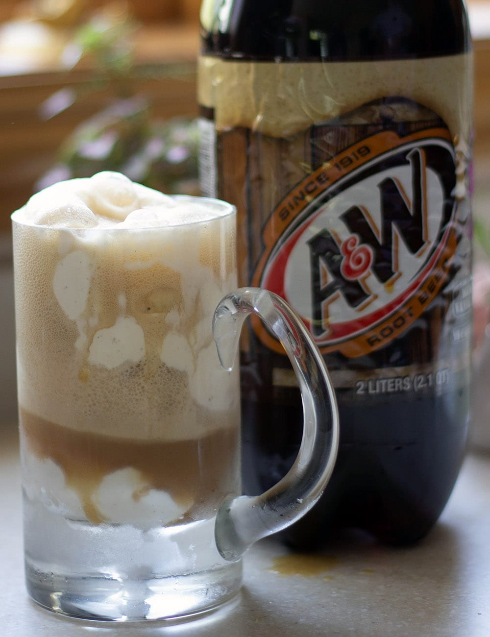 Root beer float and bottle of A&W Root Beer