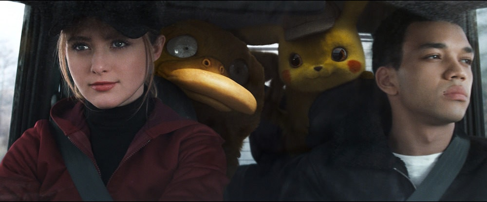 "KATRHYN NEWTON as Lucy Stevens, Psyduck, Detective Pikachu (RYAN REYNOLDS) and JUSTICE SMITH as Tim Goodman in Legendary Pictures' and Warner Bros. Pictures' comedy adventure ""POKÉMON DETECTIVE PIKACHU,"" a Warner Bros. Pictures release."