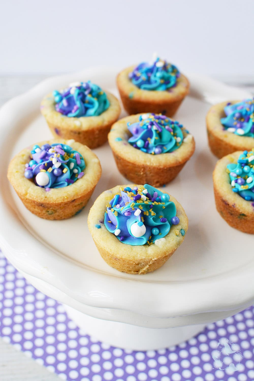 Mermaid party cookie cups on a plate.