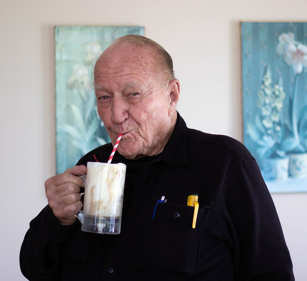 Donald VanWitzenburg drinking a root beer float.
