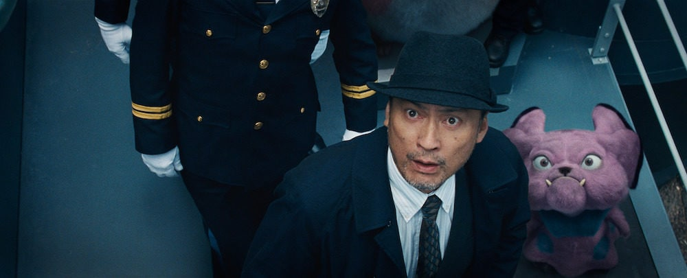 "KEN WATANABE as Lieutenant Hide Yoshida and Snubbull in Legendary Pictures' and Warner Bros. Pictures' comedy adventure ""POKÉMON DETECTIVE PIKACHU,"" a Warner Bros. Pictures release."