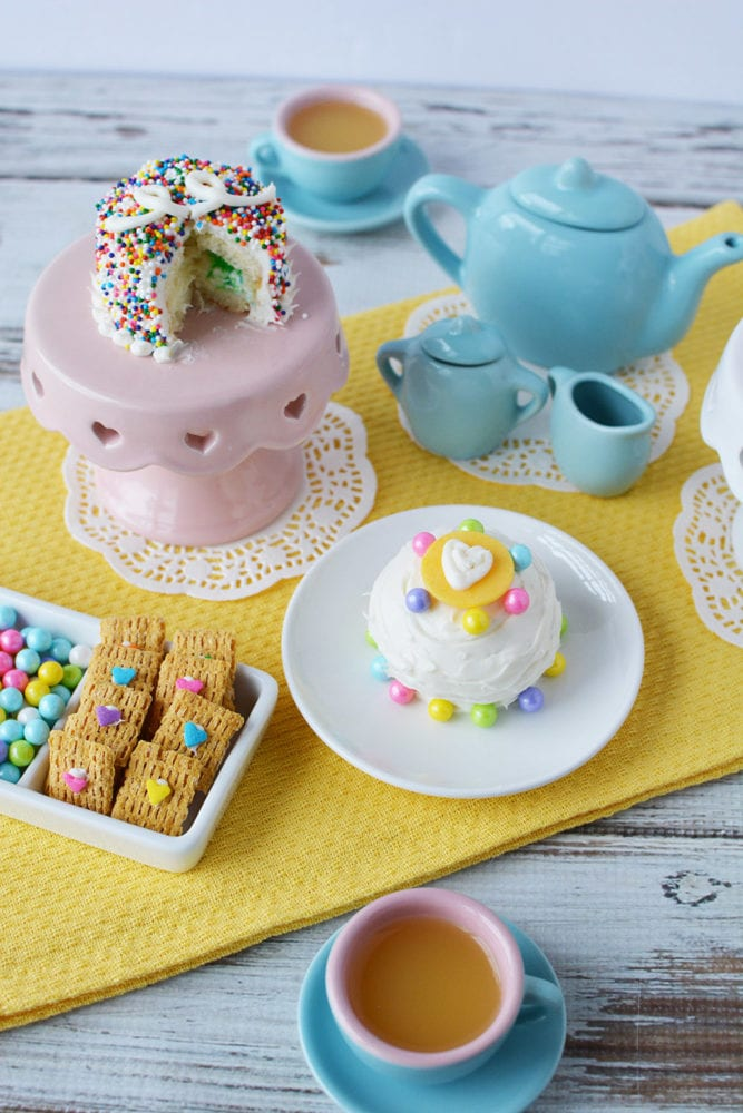 Tea party with fairy cakes and mini desserts.