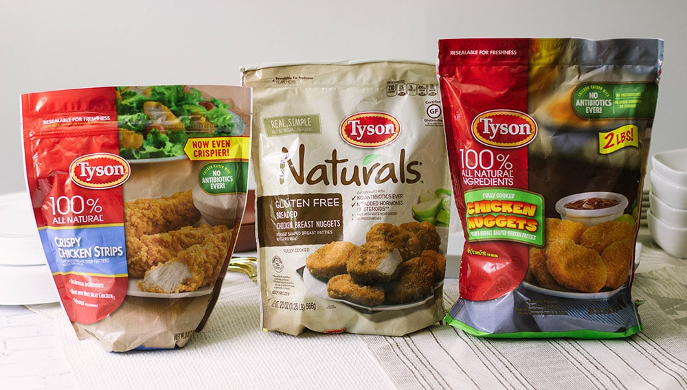 Three bags of Tyson chicken products.