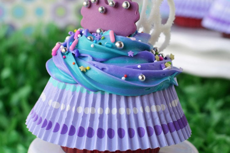 Finished fairy cupcake with wings and skirt on a cake stand