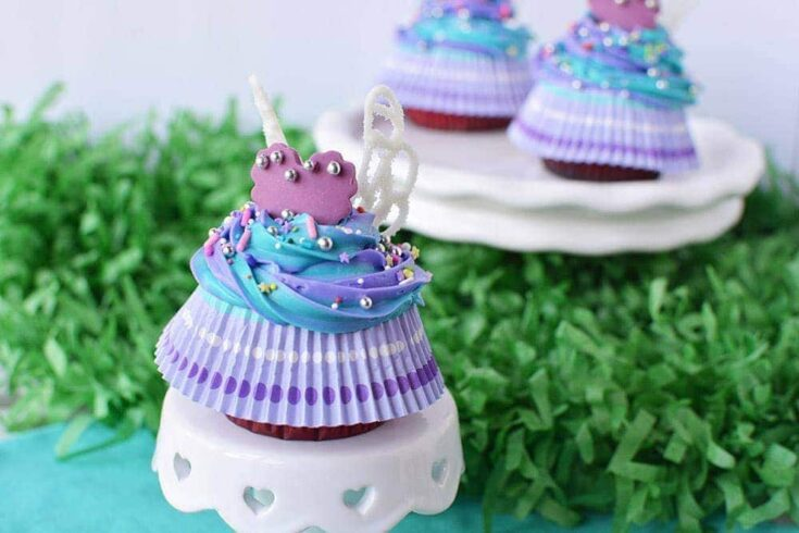 Fairy wing cupcakes on a little cake stand.